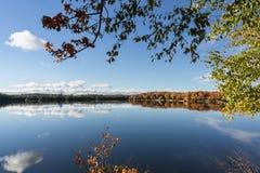 Autumn sky over the lake Ontario Canada. Autumn sky over the lake. autumnal forest Royalty Free Stock Photography