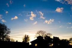 Autumn sky. With tree and house Royalty Free Stock Photography