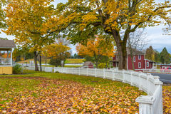 Autumn Small Town America. This scenic american pacific northwest autumn image of a rural small town residential area with picket fence, large yard, trees with Royalty Free Stock Photos