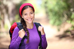 Autumn smiling young woman hiking in forest Royalty Free Stock Image