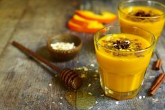 Autumn spicy pumpkin drink. royalty free stock photography