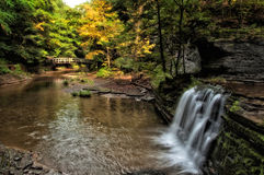 Autumn Splendor. Located in Ithaca NY, this stunning trail takes you through Buttermilk Falls Park. There are several styles of waterfalls which are breathtaking royalty free stock photo