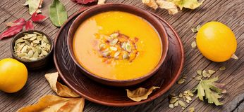 Autumn squash soup. Dietary vegetarian pupmkin cream soup.Autumnal pumpkin soup Royalty Free Stock Photography