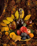 An autumn still life. With a carafe, wine and fruits Royalty Free Stock Photography