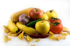 Autumn still-life. With vegetables, fruit and yellow leaves Stock Photo