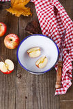 Autumn still life with apples over rustic wooden background Stock Image