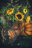 Autumn still life. Autumn bouquet of flowers with sunflowers and leaves on a dark background Royalty Free Stock Photos