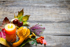 Autumn still life with candle on old boards Royalty Free Stock Image
