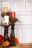Autumn still life with candles and leaves Stock Photo