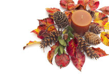 Autumn still life with colorful leaves and candle Royalty Free Stock Images
