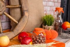 Autumn still life concept background. Fall leaves, harvest, goodies on table.Home decoration for autumn party Stock Photography