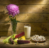 Autumn still life with corn. Popcorn and chrysanthemum Royalty Free Stock Photography