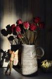 Autumn still life, dried rose, straw horse, pumpkin Royalty Free Stock Photos