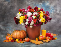 Autumn Still Life. Flowers, candles and pumpkin Royalty Free Stock Photography