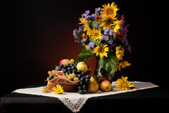 An autumn still life. Still life with fruits and flowers Stock Photography