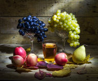 Autumn Still Life. Still life with grapes, apples, pears and fruit juice Royalty Free Stock Images