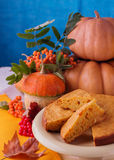 Autumn still life. Homemade Pumpkin Pie for Thanksgiving Day. Royalty Free Stock Photos