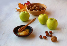 Autumn Still Life with honey, apples and nuts Stock Photos
