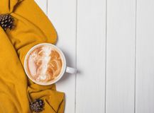 Autumn still life with hot cappuccino. And yellow sweater stock photography