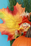 Autumn still life with leaf, scarecrow, pumpkin Stock Photography