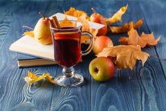Autumn still life : mulled wine with cinnamon, pear, autumn leav Royalty Free Stock Photos