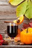 Autumn still life with mulled wine and pumpkins royalty free stock photos