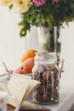 Autumn still-life, nuts, citrus fruits and book Stock Photos