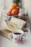 Autumn still-life, nuts, citrus fruits and book Royalty Free Stock Photo