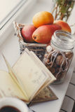Autumn still-life, nuts, citrus fruits and book Stock Photography