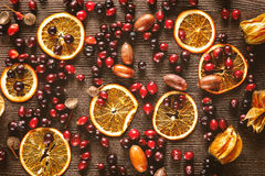 Autumn still life with orange caramel and cranberries on wood Royalty Free Stock Photography
