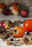 Autumn still life with persimmon Royalty Free Stock Photo