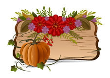 Autumn still life with pumpkin, flowers and vintage wooden board Royalty Free Stock Image