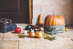 Autumn Still Life. Pumpkin and vegetables at front door Stock Images