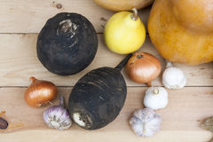 Autumn still life with pumpkins and autumn berry and vegetables on old wooden background, closeup. Selective focus Stock Photos