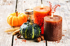Autumn still-life with pumpkins and candles Royalty Free Stock Photo