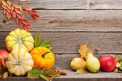 Autumn still life with pumpkins and fruits stock photos