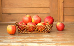 Autumn still life with red apples in wicker basket close up Stock Photos