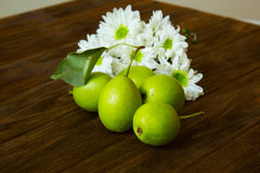 Autumn still life. Ripe pears, rustic wooden table, flowers, autumn still life. still life with colorful autumn flowers and pears Stock Photos