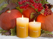 Autumn still life 2. Autumn and thanksgiving still life with pumpkins, candles and red vunurnum berries Stock Photo