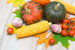 Autumn still life of vegetables and autumn maple leaves Stock Photo