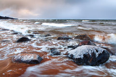 Autumn storm in the Baltic Sea to the red sand Stock Image