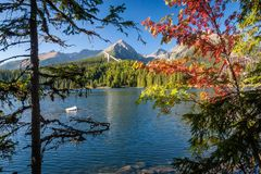 Autumn at Strbske tarn, High Tatras mountains, Slovakia. View of Strbske tarn Strbske pleso in local language in High Tatras mountains in autumn, Slovakia Royalty Free Stock Photography