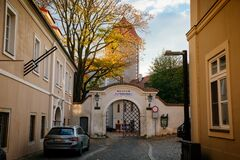 Autumn street and arched gate of the renaissance castle and regional museum in Mlada Boleslav, Central Bohemian Region, Czech