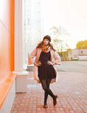 Autumn street fashion, pretty woman posing in the city Stock Photos
