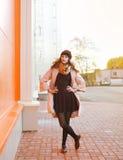Autumn street fashion, pretty woman posing in the city Stock Photos