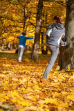 Autumn stretching in park Royalty Free Stock Photo