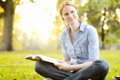 Autumn - Student Reading in a Park Royalty Free Stock Photography