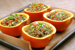 Autumn stuffed pumpkin with rice and mushrooms ready to bake Royalty Free Stock Photo