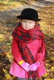 Autumn style for a little lady. Street style for a little lady for a warm autumn walk Royalty Free Stock Photography