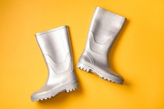 Bright gumboots on orange Royalty Free Stock Photography